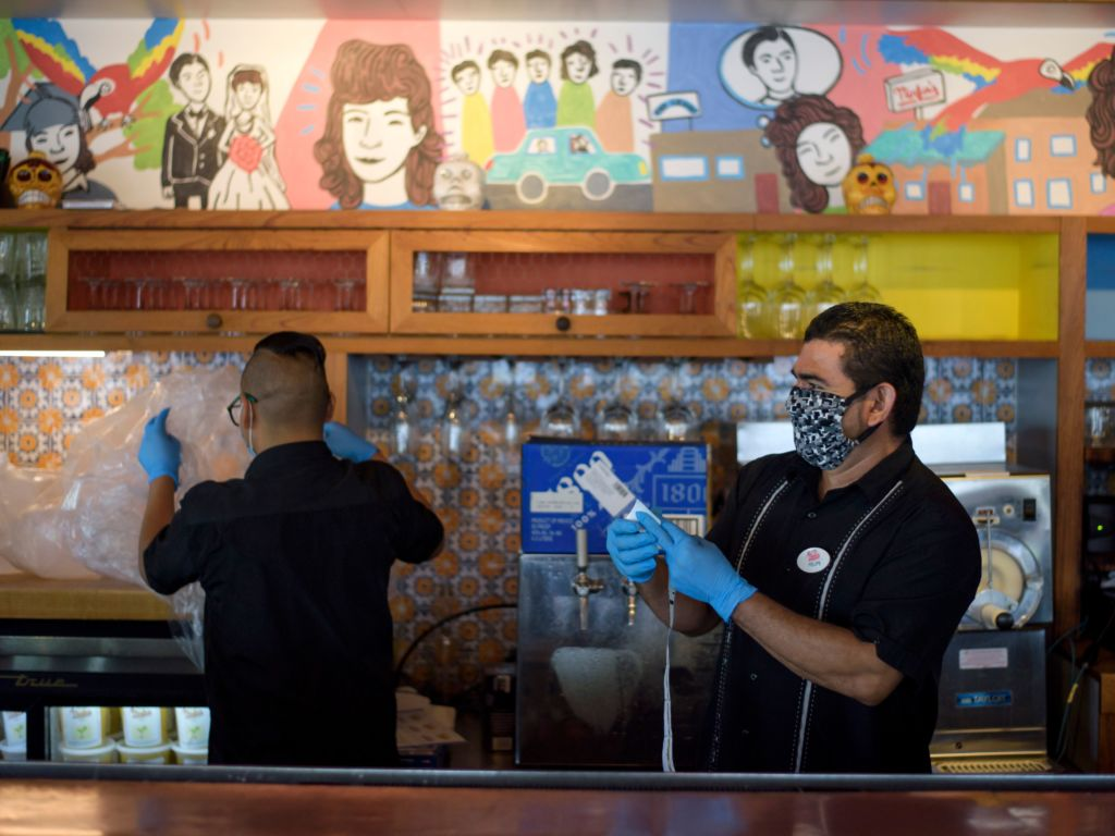 Workers prepare takeout orders in Houston on May 1. For more than two out of three unemployed workers, jobless benefits exceed their old pay, researchers say. That can raise awkward questions for workers, bosses and policymakers.