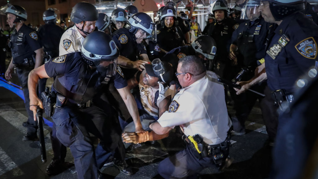 A protester is arrested on Fifth Ave. in Manhattan by New York City Police officers on Thursday.