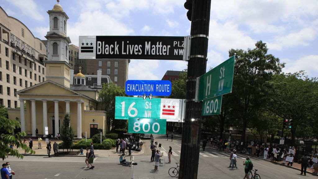 """A new street sign sits above an intersection outside St. John's Church in Washington, D.C., where President Trump arranged a photo-op this week. Mayor Muriel Bowser says, """"The section of 16th [Street] in front of the White House is now officially 'Black Lives Matter Plaza.' """""""