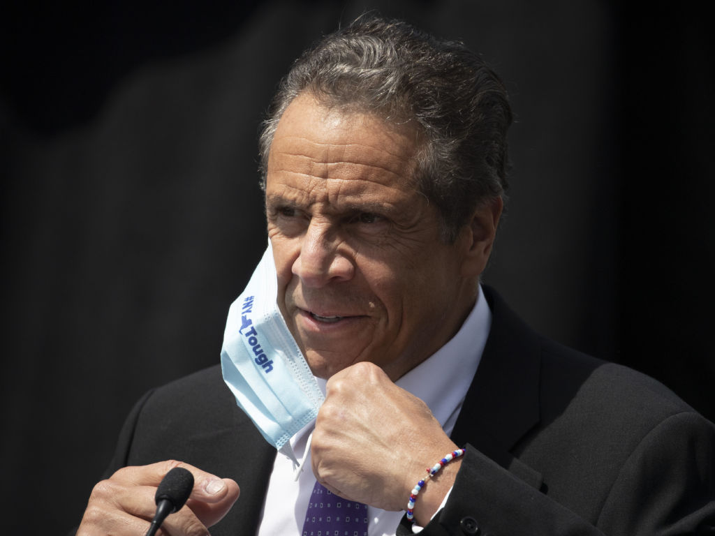 New York Gov. Andrew Cuomo, pictured at a news conference this month, joined Connecticut and New Jersey in advising travelers from 16 states with rising numbers of coronavirus to self-quarantine.