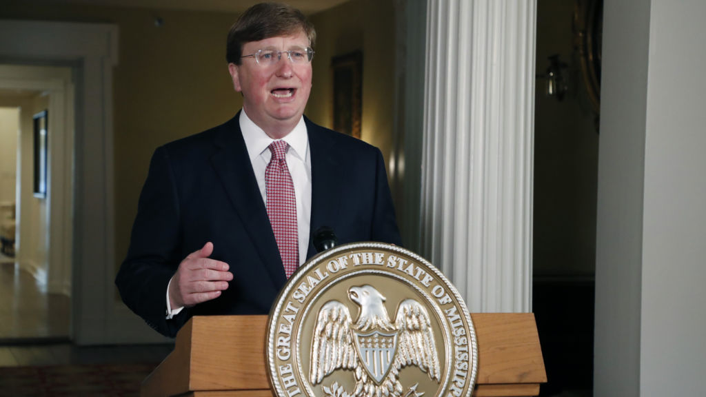 Mississippi Gov. Tate Reeves delivers a televised address prior to signing a bill retiring the last state flag in the U.S. with the Confederate battle emblem, during a ceremony at the Governor's Mansion in Jackson, Miss., on Tuesday. The legislation passed both chambers of the Legislature on Sunday.