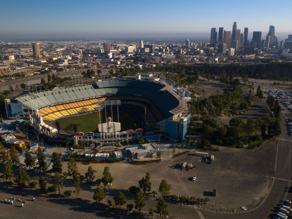 Dodger Stadium stands empty in this aerial photograph taken over Los Angeles in May. Games will resume in late July.