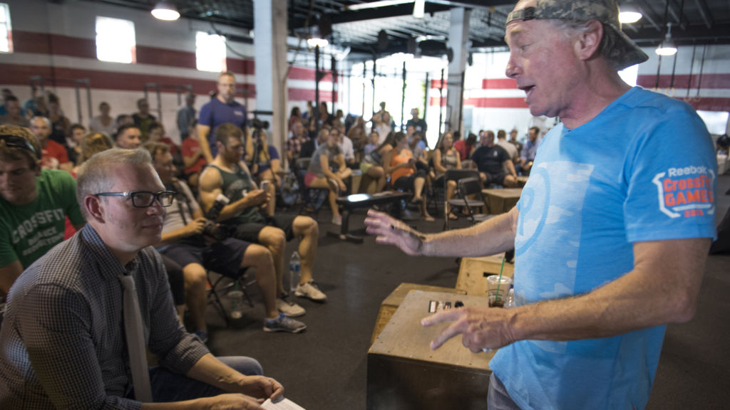 CrossFit founder and CEO Greg Glassman (right) talks to employees in Washington, D.C., on July 31, 2015. In recent days, Glassman and his company have come under fire for his insensitive comments about the Black Lives Matter movement.