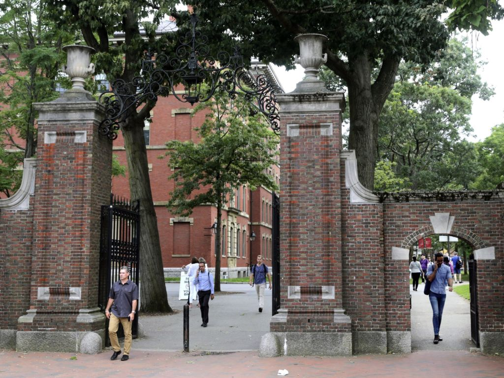 Pedestrians in Harvard Yard in 2019. Schools and businesses have gone to court to stop the Trump administration from barring online-only international students from entering or staying in the U.S.