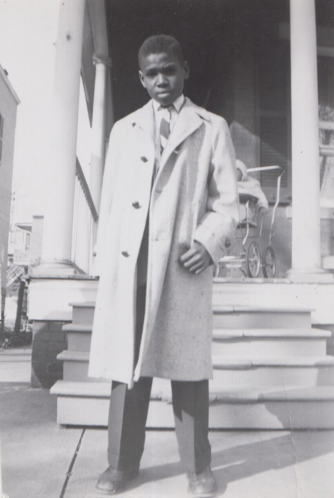 A young Reginald F. Lewis at home in Baltimore, MD.