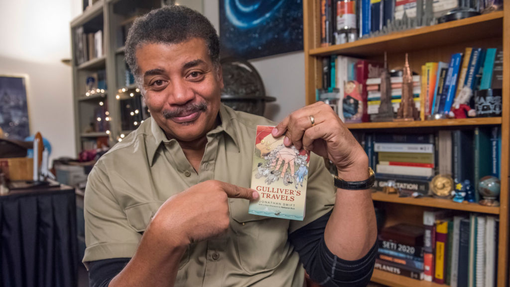 Neil deGrasse Tyson, a guest on The Great American Read, holds his copy of Gulliver's Travels