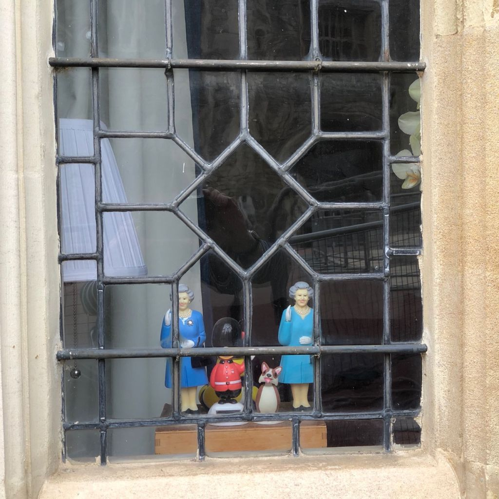 Queen Elizabeth figurines in window at Windsor Castle, one of her royal residences.