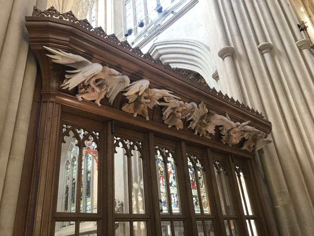 Carved wooden angels on the squire of Bath Abbey.